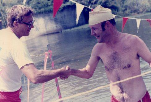 Congratulating Larry Williams - 4th Annual 'Right Distance Mile' Lake Swim - Lake Norrell - Aug 1985